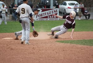 Naugatuck's John Dean (11) steals second base April 14 versus Kennedy at Rotary Field in Naugatuck. The Greyhounds beat the Eagles, 8-3. After losing their first game, Naugy has rattled off five straight wins. –ELIO GUGLIOTTI