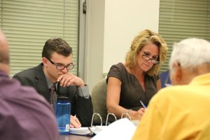 Burgess Alex Olbrys, left, and Deputy Mayor Tamath Rossi review budget documents Thursday night in Naugatuck Town Hall. The Joint Boards of Finance and Mayor and Burgesses approved a $115.2 million budget for the 2014-15 fiscal year. –LUKE MARSHALL