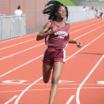 Naugatuck's Faith Okifo crosses the finish line in first place during in the 4x100 meter relay race May 13 during a meet against Wilby and Crosby in Naugatuck. The Naugatuck boys and girls teams won the meet. –LUKE MARSHALL