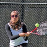 Woodland's Ayah Galal charges the net to return a shot during a doubles match May 5 versus Kennedy in Beacon Falls. Galal and her partner Katie Rioux won their match 8-0, as the Hawks defeated the Eagles 6-1. –ELIO GUGLIOTTI
