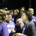 Naugatuck High School world language teacher Rebecca Cruz, who passed away last week from pancreatic cancer, talks with students on the school's track June 13, 2014 during Cruz Night. –FILE PHOTO