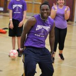 Naugatuck High student Francois Kazadi has some fun in the gymnasium while waiting for the rain June 13 during Cruz Night. –ELIO GUGLIOTTI