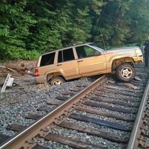 This SUV got stuck on Metro North train tracks Thursday morning and disrupted service. Nobody was injured. –CONTRIBUTED