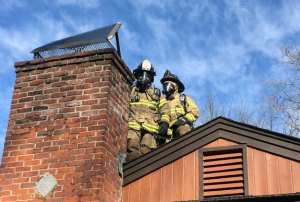 Beacon Hose Company No. 1 firefighters work on the scene of a small chimney fire at a home on Skokorat Road in Beacon Falls Sunday morning. –CONTRIBUTED