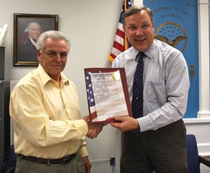 Beacon Falls First Selectman Christopher Bielik, right, presents former Selectman Dominic Sorrentino with a certificate of recognition Nov. 9 for his years of public service. –LUKE MARSHALL