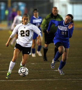 Woodland's Jessica Rodrigues (23) pushes the ball up field against St Paul's Sydney Palma (21) during the NVL semifinals Monday at Municipal Stadium in Waterbury. Woodland won, 2-0. –REPUBLICAN-AMERICAN