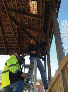 Naugatuck Public Works Department employee Shawn Kuczenski installs video surveillance cameras at the gazebo on the Naugatuck Green Dec. 4 with DPW worker Dan Hennessey. -REPUBLICAN-AMERICAN