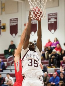 Naugatuck's Fejiro Onakpoma grabs the rebound Dec. 29 in Naugatuck against Wolcott. Naugatuck won the game, 56-41. –REPUBLICAN-AMERICAN