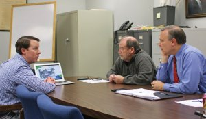 Jordan Energy Director of Commercial Sales Adam Burkitt, left, presents a solar energy project to the Beacon Falls Board of Selectmen Tuesday night at Town Hall as First Selectman Christopher Bielik, right, and Selectman Michael Krenesky listen. –LUKE MARSHALL
