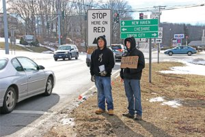 Prospect Congregational Church Youth Group members Collin Lacovelli, left, and Nicholas Hudson collect money to help the homeless at the intersection of Route 68 and Route 69 in Prospect Jan. 30 during the group's 14th annual Homeless Awareness Sleepout. –LUKE MARSHALL