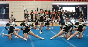 Members of the Woodland cheerleading team run through their routine during the NVL cheerleading championships Saturday at Crosby High School in Waterbury. -REPUBLICAN-AMERICAN
