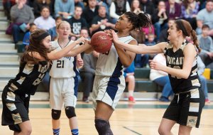 Kennedy's Destiny Prather (33) loses the ball while being defended by Woodland's Morina Bojka (22) and Carla Piccolo (10) during an NVL quarterfinal game Saturday at Holy Cross High School in Waterbury. Kennedy won the game, 58-38. Woodland opens the Class M tournament Monday versus Coginchaug. -REPUBLICAN-AMERICAN
