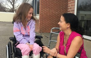 Western Elementary School second-grader Olivia Thompson chats with Principal Brenda Goodrich before entering school Thursday for the first time since having a heart transplant in November. Oliva, 7, is feeling great; her body has accepted the transplant, and she is happy to be back with her friends. -REPUBLICAN-AMERICAN