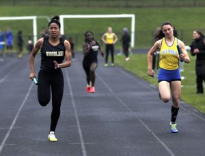 Woodland's Erika Michie, left, sprints to the finish ahead of Seymour's Sarah Granese in the 4x100 relay during a meet with Kennedy and Waterbury Career Academy in Beacon Falls on Tuesday. -REPUBLICAN-AMERICAN