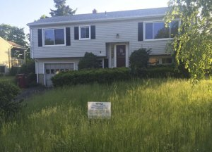 This vacant house on Rough Wing Road in Naugatuck has overgrown grass and brush. It has been cited as an example of blight in Naugatuck. Borough officials are trying to strengthen penalties to combat blight. –RERPUBLICAN-AMERICAN