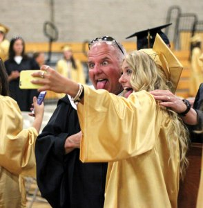 Woodland Regional High School graduate Lauren Lombardo takes a selfie with Woodland teacher Mike Magas before graduation June 16 at the school in Beacon Falls. –ELIO GUGLIOTTI