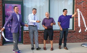 From left, Project Purple Founder and Board of Directors Chairman Dino Verrelli, pancreatic cancer survivor Kevin King of Wallingford, pancreatic cancer survivor Ron Hiznay of Shelton, and Project Purple Board of Directors member Alexander Palios celebrate June 30 after a ribbon cutting to officially open the nonprofit's new office at 94 North Main St. in Beacon Falls. –LUKE MARSHALL