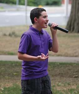 Vinny Longo, 12, of Naugatuck, sings 'Bring me to life' by Evanescence July 28 during Titanium Day on the Naugatuck Green. The event was held to raise awareness of domestic abuse and the services offered to victims by Safe Haven of Greater Waterbury. –ELIO GUGLIOTTI