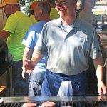Bill Zembruski, of Boy Scout Troop 138, grills up food during the Harvest Moon Festival on the Naugatuck Green on Sept. 17. –LUKE MARSHALL