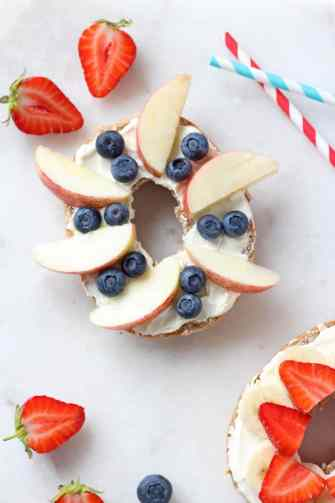A super easy breakfast for kids; a bagel topped with honey and vanilla cream cheese and fresh fruit   My Fussy Eater blog