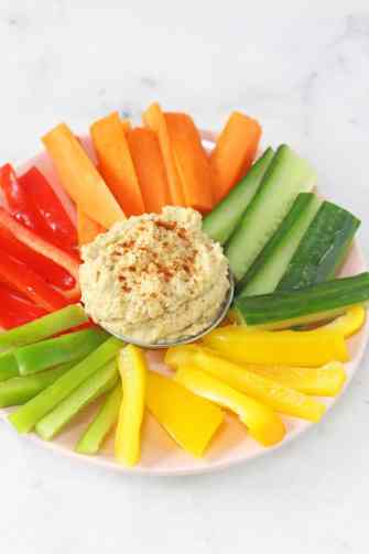 Serve up this delicious, healthy and fun Cheese, Veggie & Green Olive Hummus wrap for kids and watch them have a giggle with their lunch! | My Fussy Eater blog