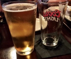 a glass of angry orchard cider