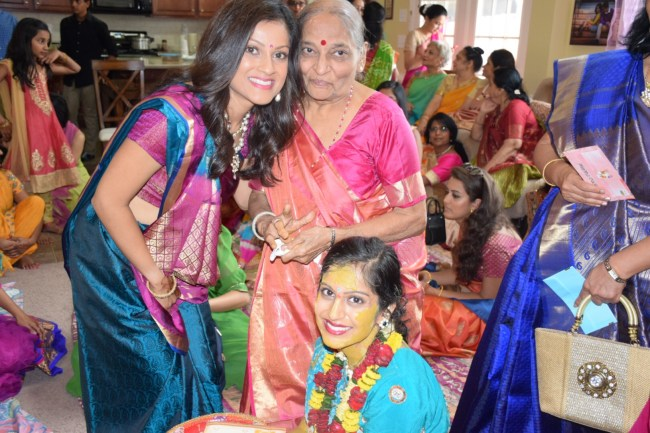 Granddaughters at Hindu wedding vidhi ceremony with grandmother