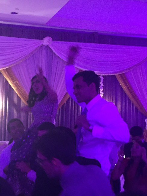 Happy couple dancing at their wedding reception
