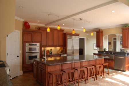 home de kitchen design with island completed with chairs