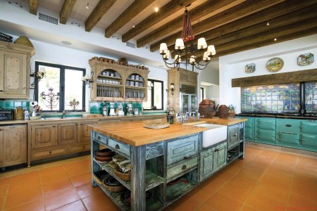 wide mexican contemporary kitchens with rustic blue island and wooden islandtop under clic chandelier