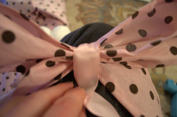 glue a piece of ribbon around the center