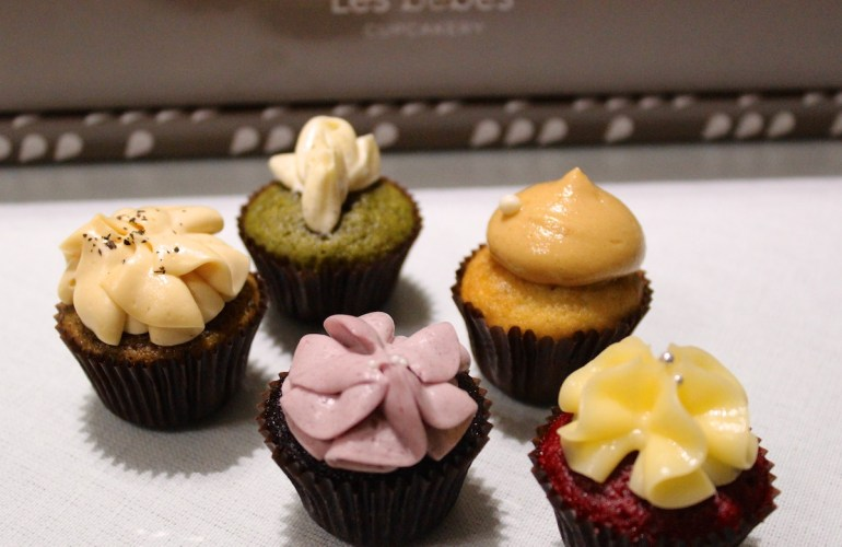Back Row (2): Passion Fruit Matcha and Berry Banana. Front Row (3) Sea Salt Caramel Darjeeling, Berry Chocolate, and Red Velvet.