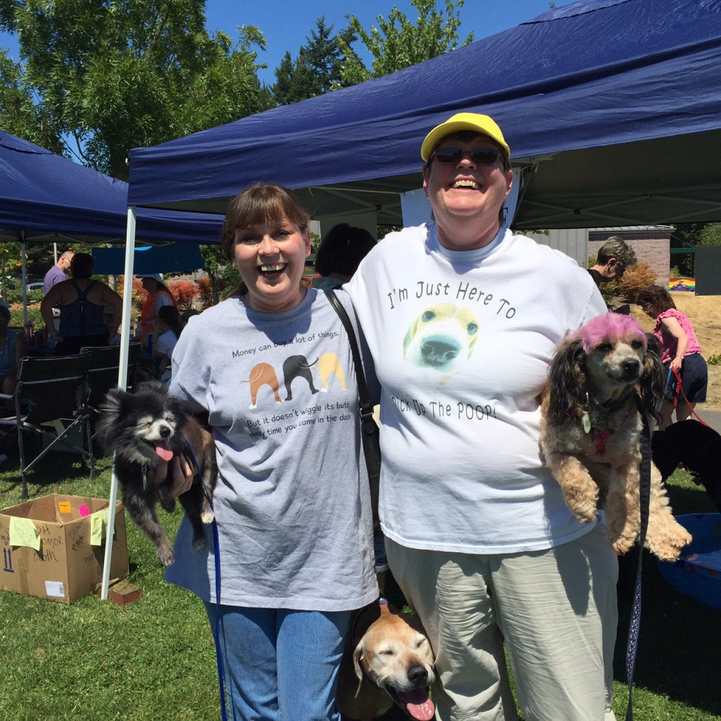 Vikki Kiehl, left, and Diana Halstead, right, are pictured holding senior dogs Allie, left, and Charlotte, right. (Photo by Laura T. Coffey)