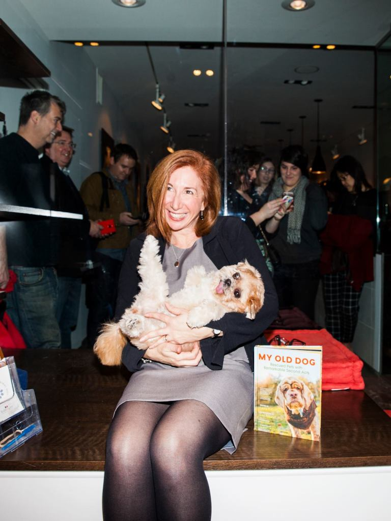 """My Old Dog"" author Laura T. Coffey snuggles Marnie the dog at Koneko Cat Cafe in New York City on Dec. 10, 2015. Internet-famous Marnie really brought out the paw-parazzi. (Photo credit: David Williams)"