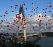 Red and white balloons, symbolising the colours of Turkish national flag,float in the air during the inauguration of the new Yavuz Sultan Selim Bridge, the third bridge over the Bosporus, in Istanbul, Friday, Aug. 26, 2016. (Tolga Adanali, Depo Photos via AP)