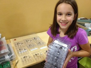 Katie carries a boxs for apolLO I synthesizer kits