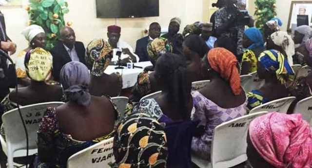 Image result for 82 freed Chibok girls arrive Abuja, to meet Buhari