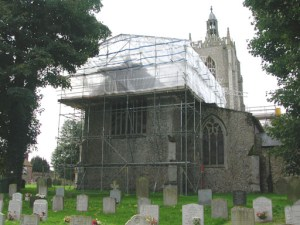 Covered independent scaffolding (Haki System) at Necton Church.
