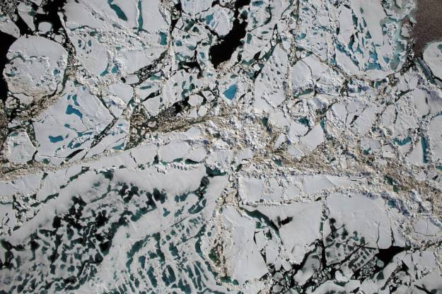 overhead view of sea ice showing brown sediments