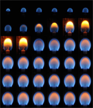 A composite image of candle flames from the Burning and Suppression of Solids (BASS) investigation