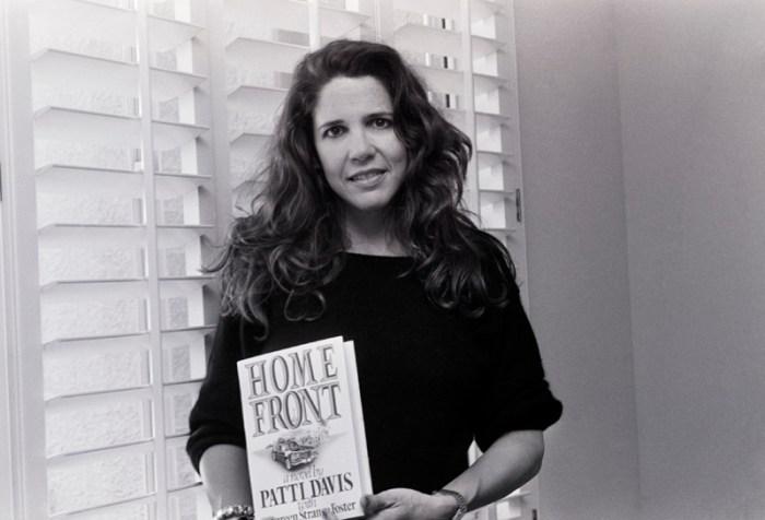 Patti Davis Holding Her Book
