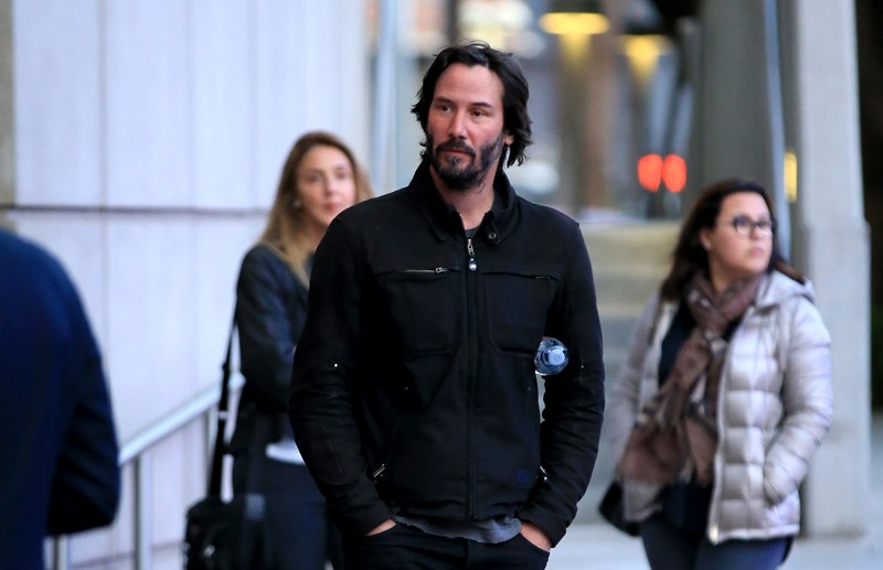 Keanu Reeves arrives at The Who concert at the staples with a mystery girl  Pictured: keanu reeves Ref: SPL1290241  250516   Picture by: LEADER / Splash News  Splash News and Pictures Los Angeles:	310-821-2666 New York:	212-619-2666 London:	870-934-2666 photodesk@splashnews.com