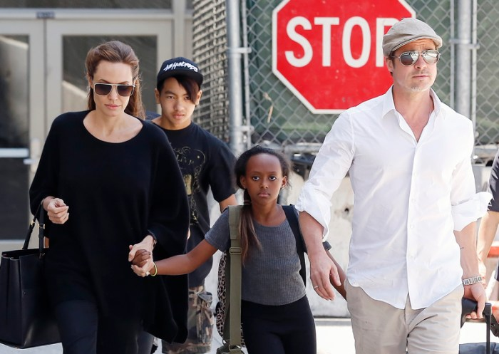 Brad Pitt and Angelina Jolie arrive a LAX airport with some of their kids in Los Angeles