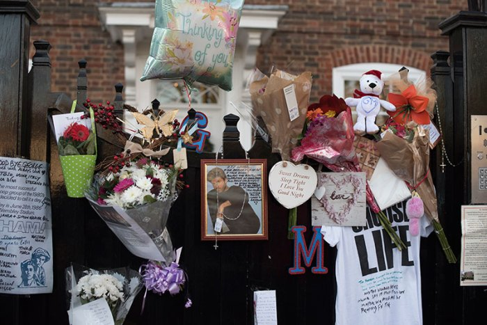 Fans pay homage to George Michael outside his house at