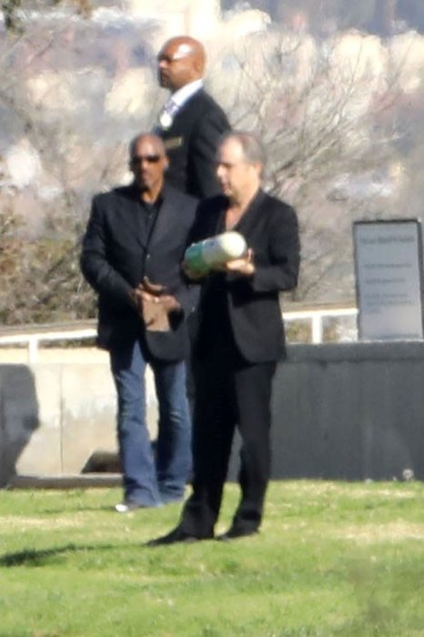 Todd Fisher holds Carrie Fisher's Urn during Funeral