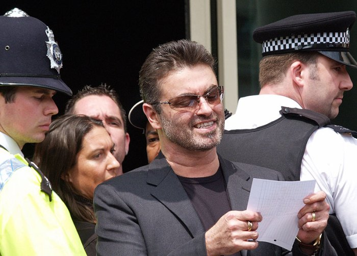 British singer George Michael reads a st