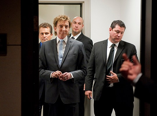 Barry Manilow, second from left, waits to address a briefing with the Congressional Heart and Stroke Coalition in the Capitol Visitor Center on his battle with atrial fibrillation and how the disorder effects 2.5 million Americans.