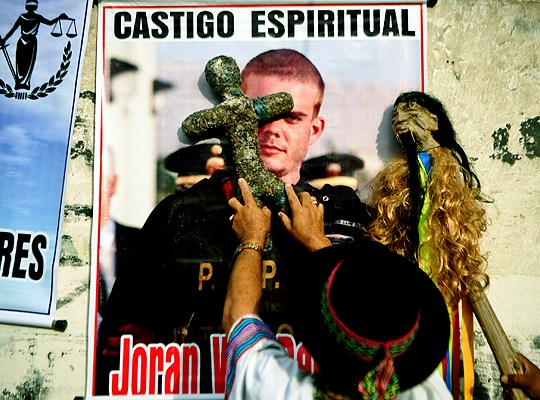 Peruvian shamans perform a ritual of spiritual punishment for Dutch national Joran Van der Sloot before his hearing before court at the Lurigancho prison in Lima on January 6, 2011. Trial gets in Lima for the Dutch national Joran Van der Sloot, accused of killing a young Peruvian woman in 2010 and who also is a suspect in the disappearance years earlier of an American woman in the Caribbean