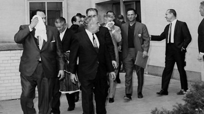 Carlos Marcello (in foreground looking to the right) and other members of Cosa Nostra leaving Queens County Court.