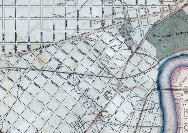 This 1863 map by Samuel Smedley shows actual roads in tan and planned roads outlined in black. Note the headwaters of Perch Creek at the foot of today's S. St. Bernard Street. Further east is the dammed Mill Creek in today's Clark Park. (Via HistoricMapWorks.com)